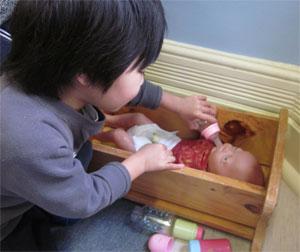 Boy-feeding-baby-small.jpg