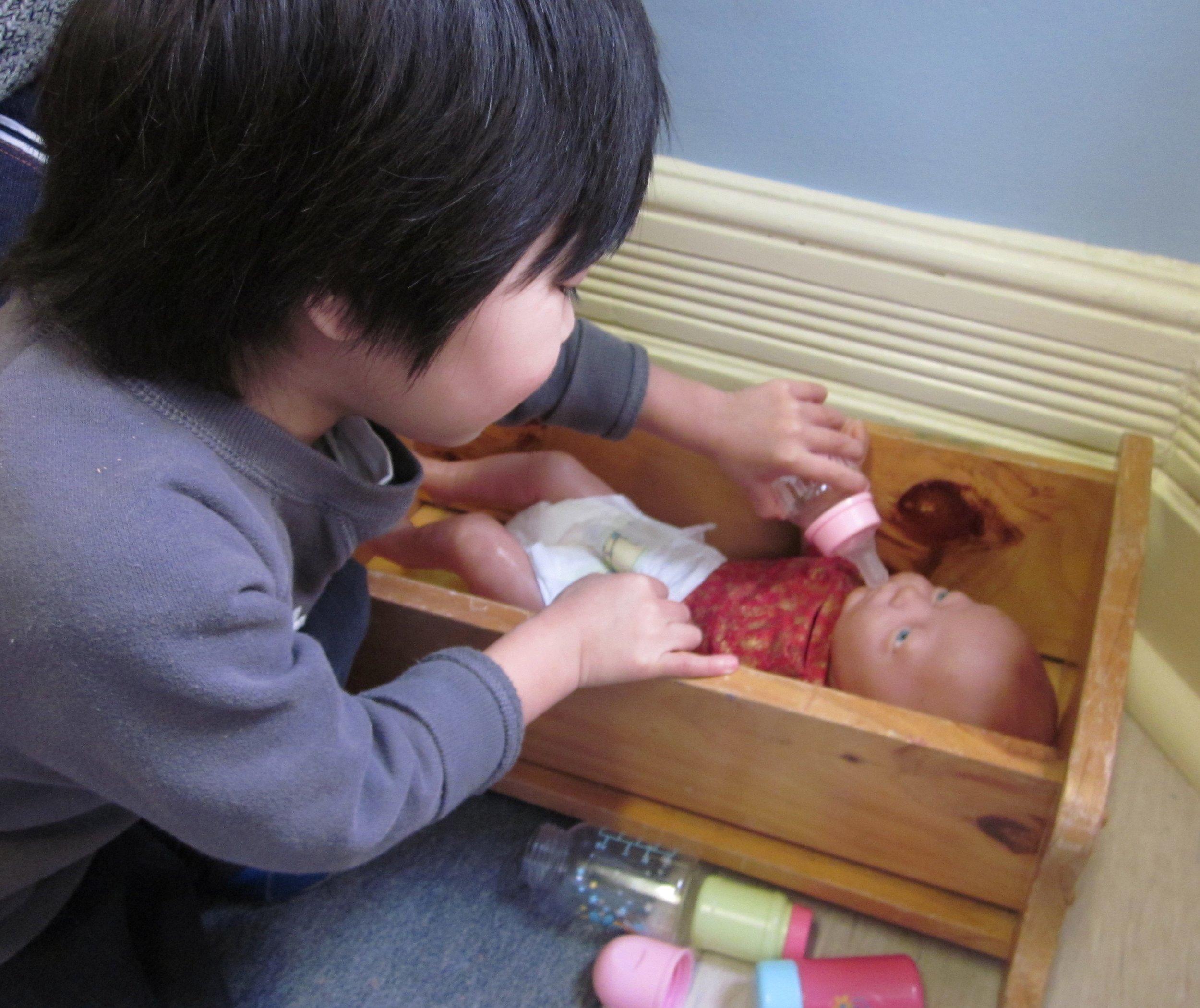 Boy feeding baby.jpg