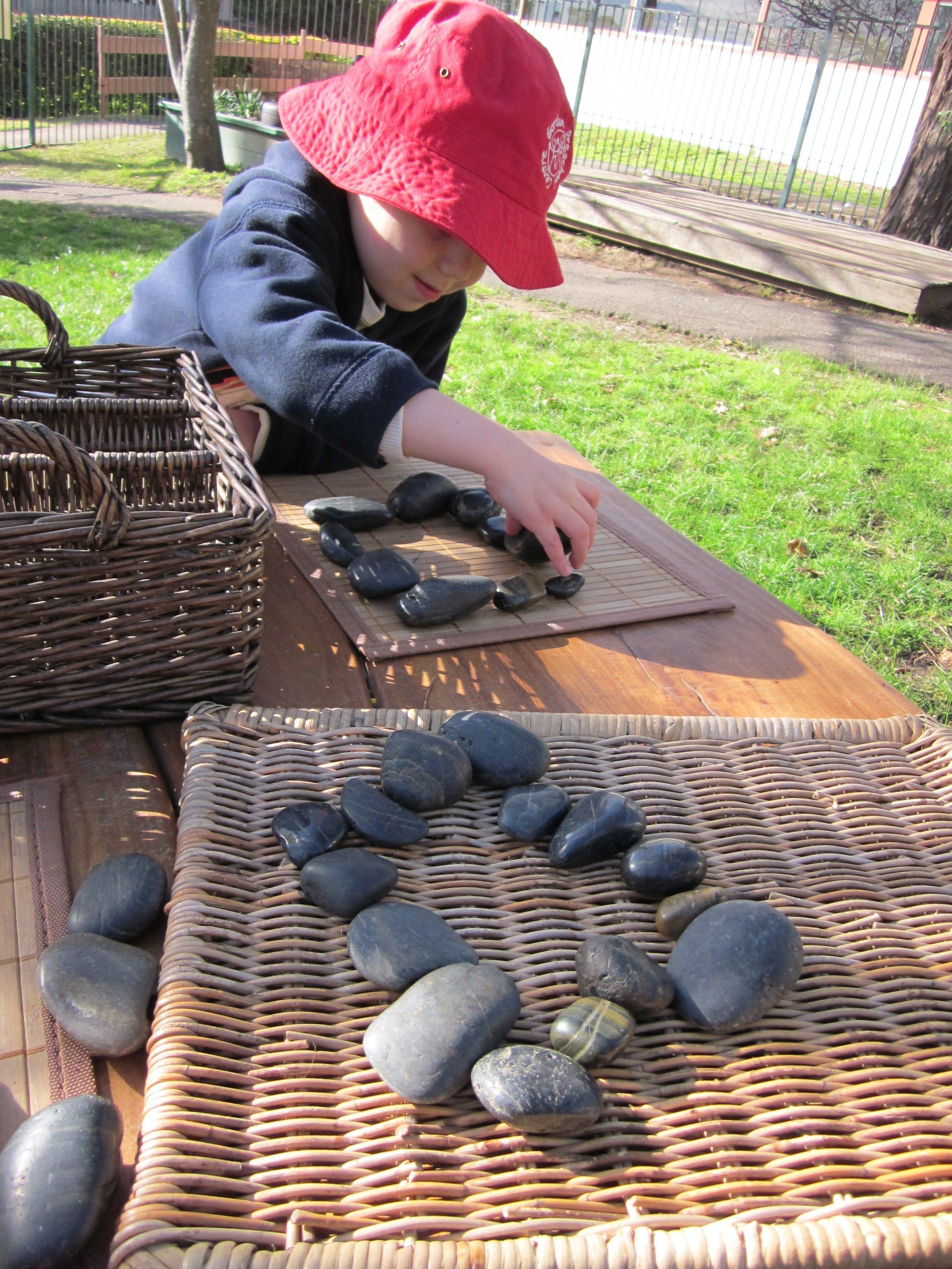 Boy making stone patterns.jpg