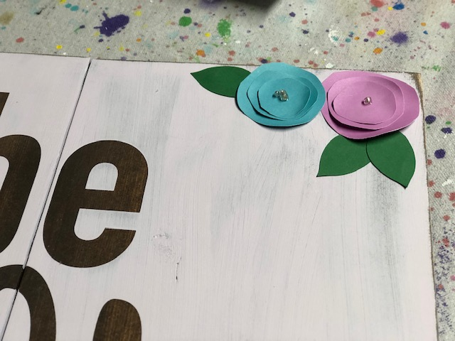 How to make paper flowers to add to a rustic sign
