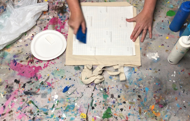 How to stencil on a canvas bag. Learn how to faux screen print to personalize your canvas totes.