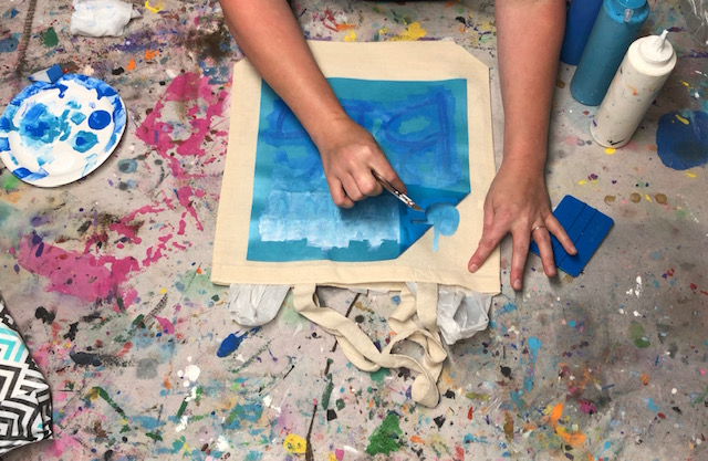 How to stencil on a canvas bag. Learn how to faux screen print so you can personalize your canvas totes.