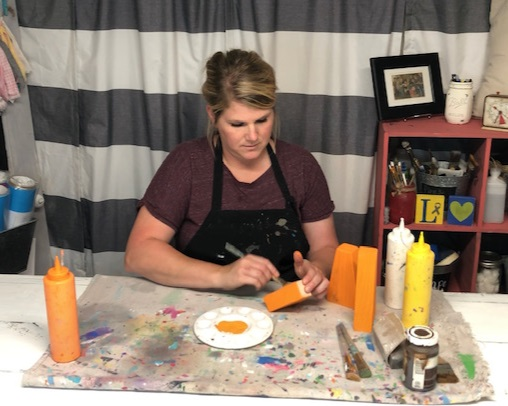DIY candy corn decorations. How this mom made her own from a scrap 2x4