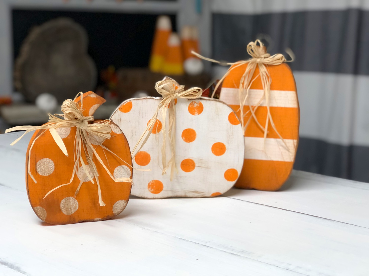How to paint wood pumpkin cutouts. This easy DIY kit has everything you need to DIY this sweet and simple rustic fall decor.