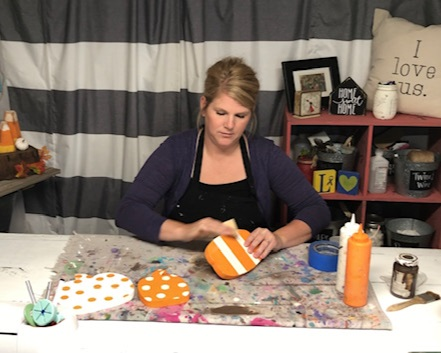 How to paint wood pumpkin cutouts. This easy DIY kit has everything you need to DIY this sweet and simple rustic fall decor. How to distress wood pumpkins.