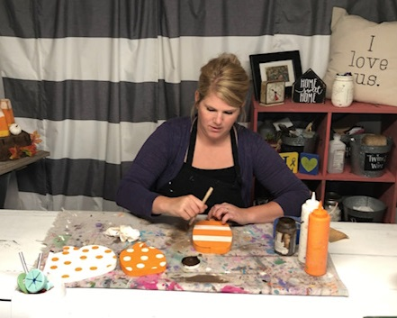How to paint wood pumpkin cutouts. This easy DIY kit has everything you need to DIY this sweet and simple rustic fall decor. How to apply antiquing wax to wood pumpkins.