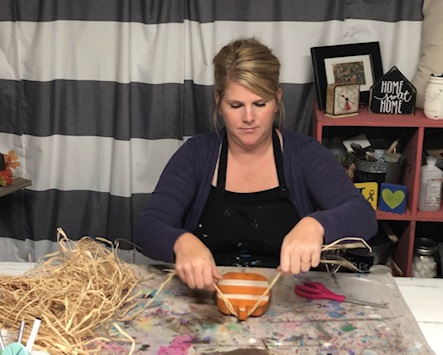 How to paint wood pumpkin cutouts. This easy DIY kit has everything you need to DIY this sweet and simple rustic fall decor. How to add raffia to your wood pumpkins.