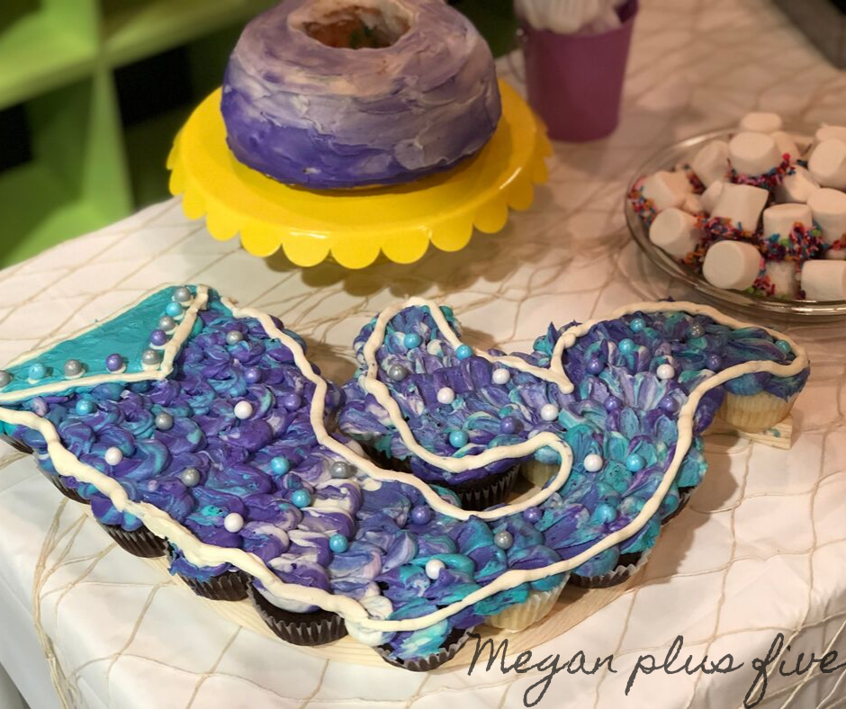 . I used a combination of purple, teal, and white for the frosting colors and I didn't even use any fancy piping tips {I was a little pressed for time lol}. For under $10 I was able to make the cake of her mermaid themed birthday dreams!