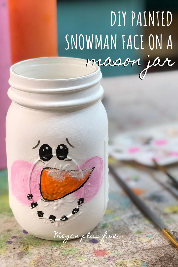 DIY how to paint a snowman face on a mason jar. Easy winter craft using mason jars. How to paint snowmen on glass.