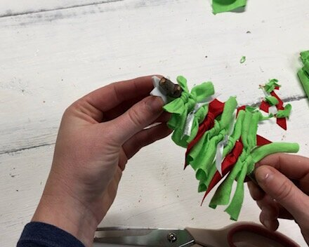 DIY fabric and ribbon Christmas tree ornament. How to make super frugal ornaments for Christmas with your kids. Easy stick tree ornament