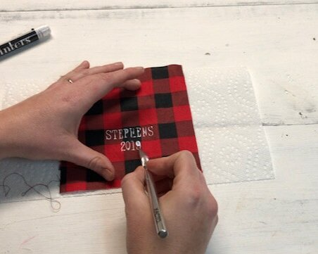 DIY personalized mason jar lid ornament using buffalo plaid. How to make Christmas ornaments out of rusty canning jar lids and your Cricut