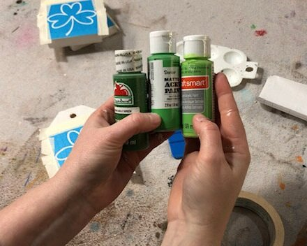 DIY craft kit for adults. How to make mini wood tags for St. Patrick's Day using your Cricut. How to stenicil wood signs for spring.