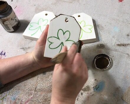DIY craft kit for adults. How to make mini wood tags for St. Patrick's Day using your Cricut. How to stenicil wood signs for spring. How to apply antiquing wax to wood.