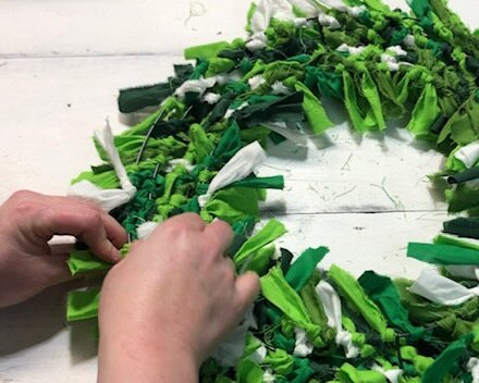 DIY Dollar Tree rag wreath for St. Patrick's Day. How to make an easy rag wreath using a Dollar Tree wire wreath form and scraps of fabric or fat quarters.