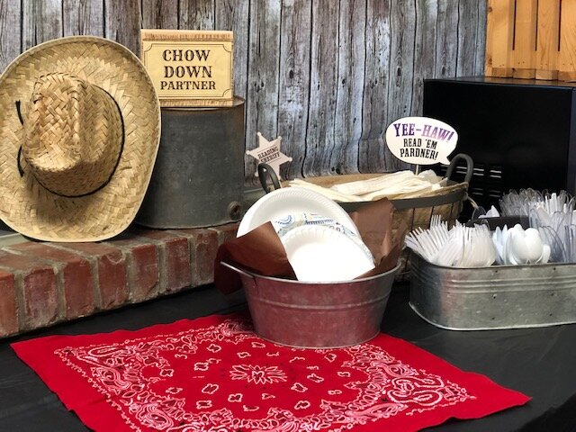 Wild  west themed party table sign DIY. How to put together a chow down partner sign for your western themed party.