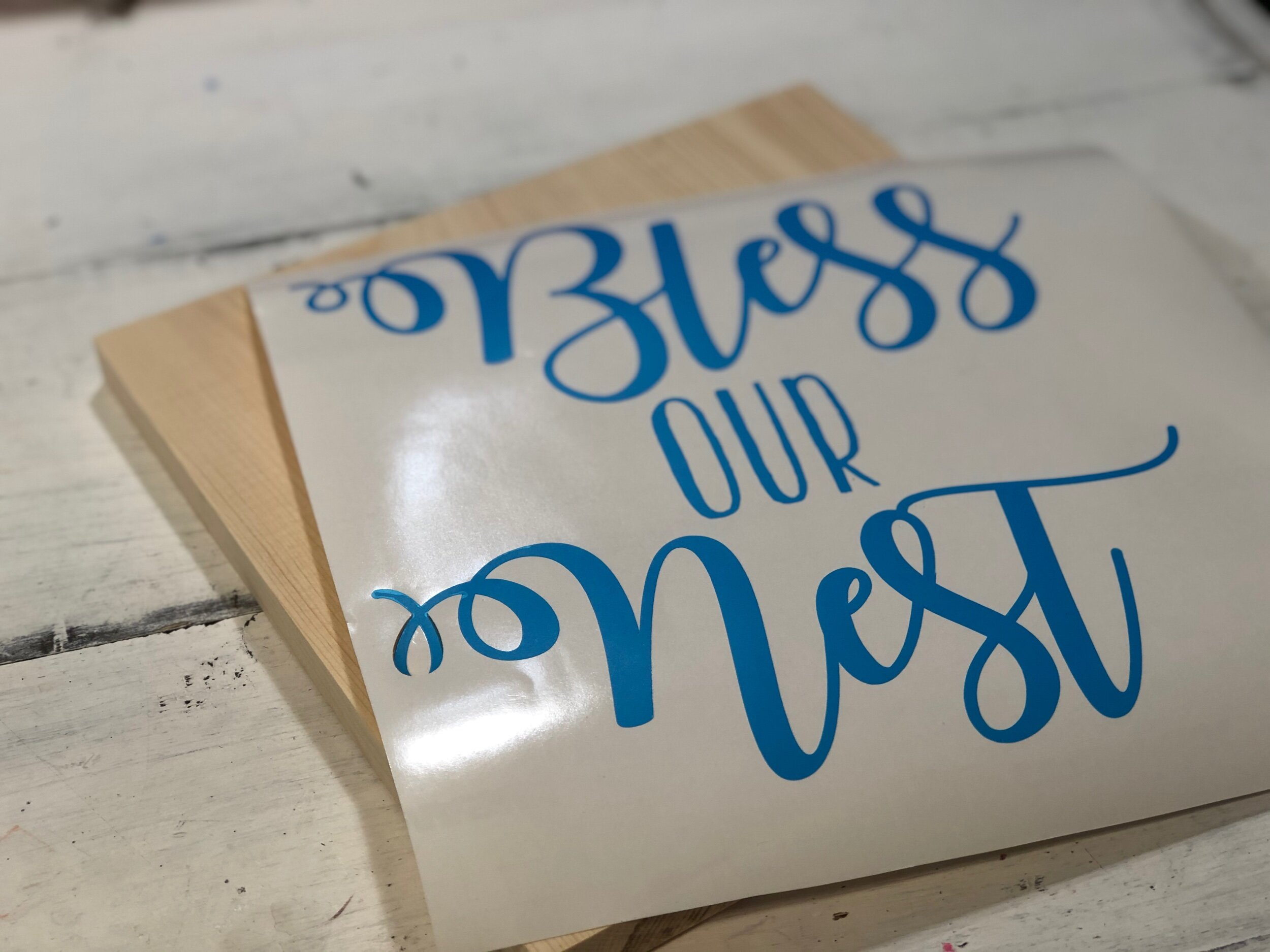 Bless our nest wood sign, how to paint a sign with no paint bleed. Reverse stencil method is perfect for new sign painters to get their feet wet in the sign painting world. Grab your FREE wooden sign svg for stenciling. Make your own rustic bless our nest wooden sign