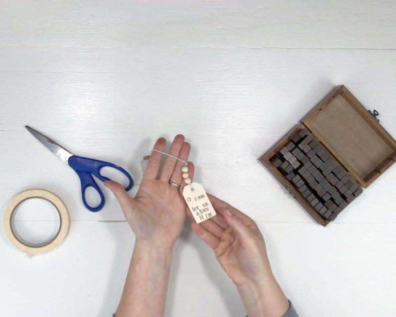 How to make a wood tag Christmas ornament. DIY Christmas ornament with wood beads. How to stamp on wood. O come let us adore Him Christmas DIY.