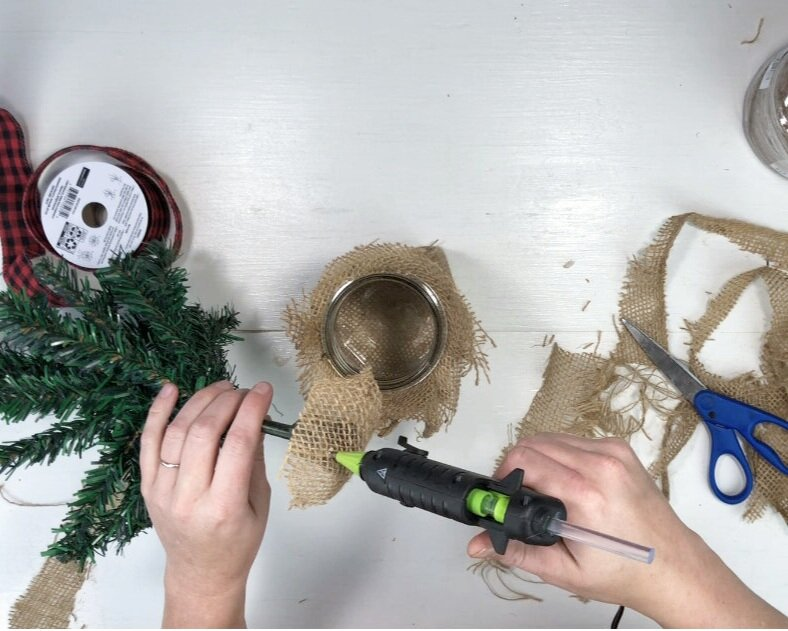 DIY Dollar Tree farmhouse Christmas tree. What to do with the mini Christmas trees from the dollar tree. Easy way to use the cheap Christmas trees from the dollar store. Rustic farmhouse Christmas decor on a budget.