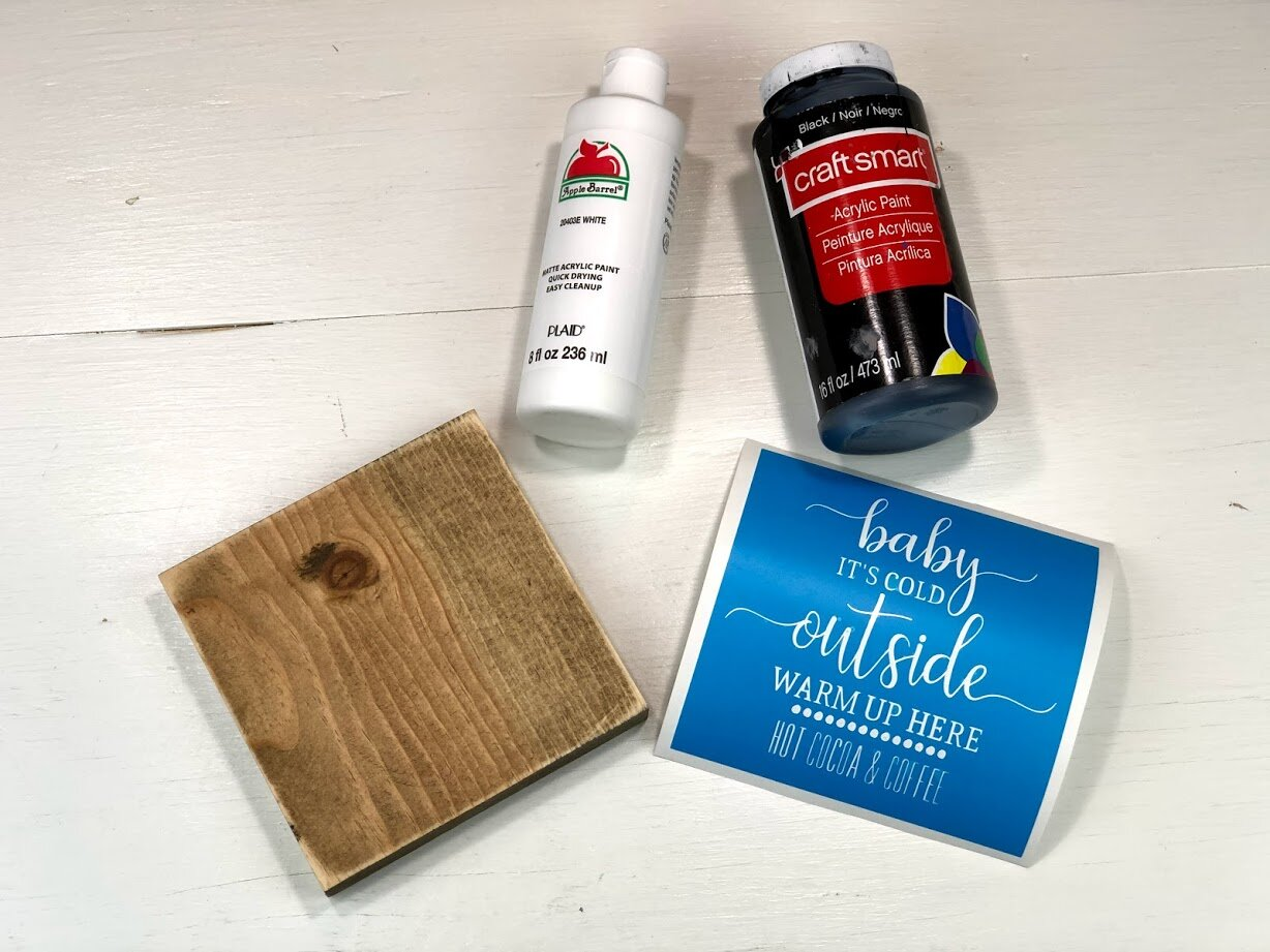 DIY baby it's cold outside warm up here hot cocoa & coffee bar wood sign. Free SVG for winter coffee bar sign. How to stencil on wood with no paint bleed. DIY wood sign painted stenciled sign with acrylic paint and oramask stencil film.