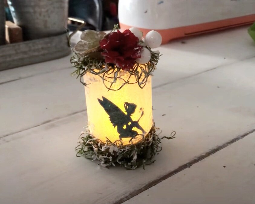 DIY glittered light up fairy jar Christmas ornament. Super cute Dollar Tree Christmas ornament DIY craft tutorial for the holiday season. How to make inexpensive Christmas ornaments the kids will love. Pretty make your own Christmas tree ornament craft tutorial.