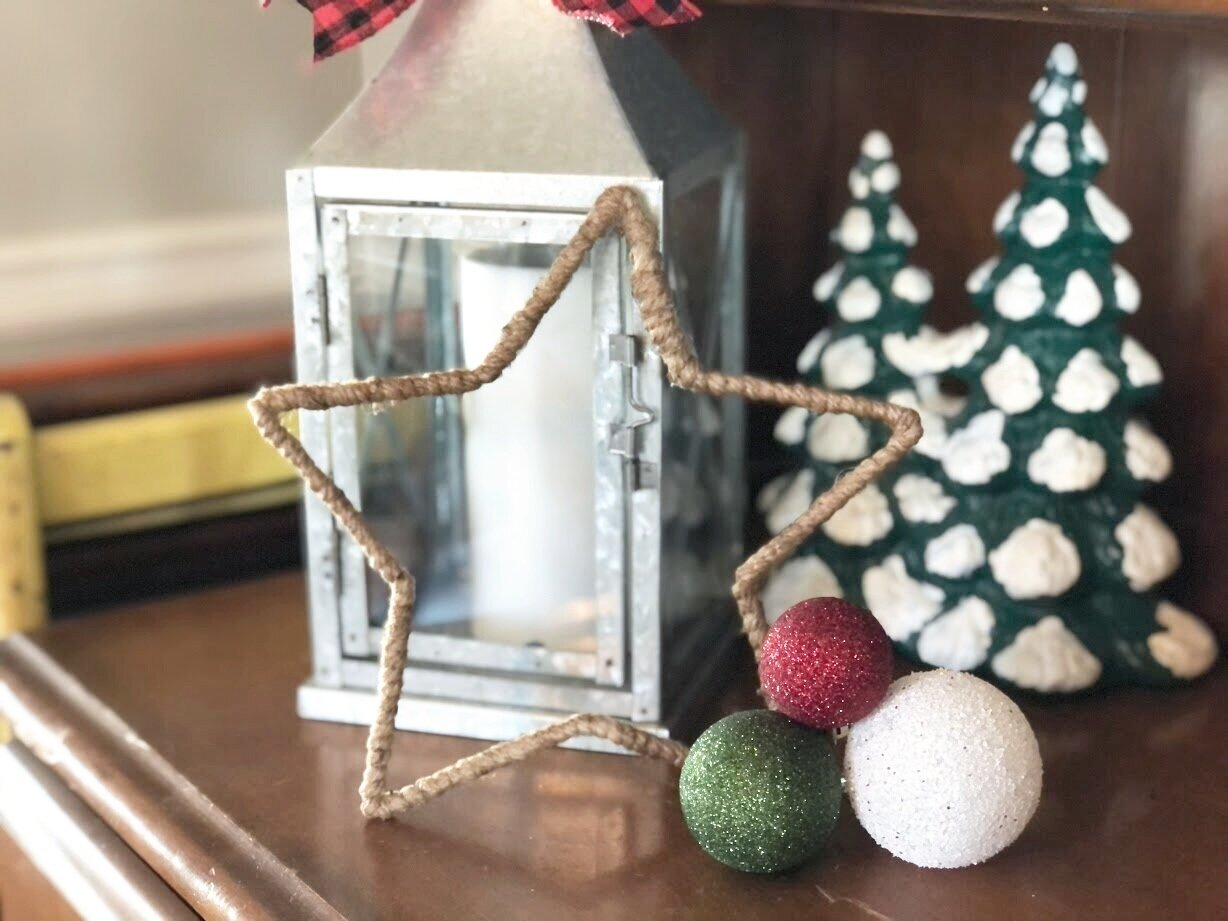 DIY dollar store Christmas decor. Christmas decorations on a budget. How to make a rustic farmhouse style star using twine or just and a wire star form.