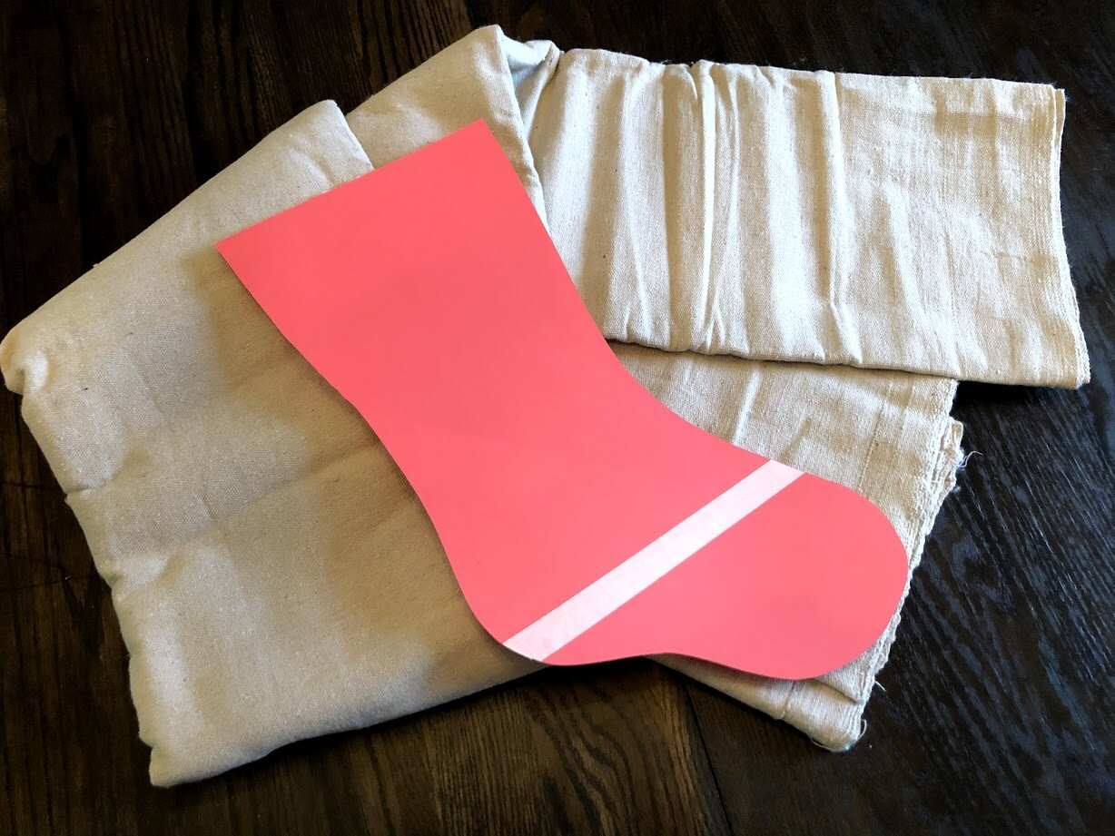 How to have a stress free stocking party with your kids. Make cute Christmas stockings out of drop cloths. DIY Christmas stockings plus a free sock stocking SVG to use with your Cricut.