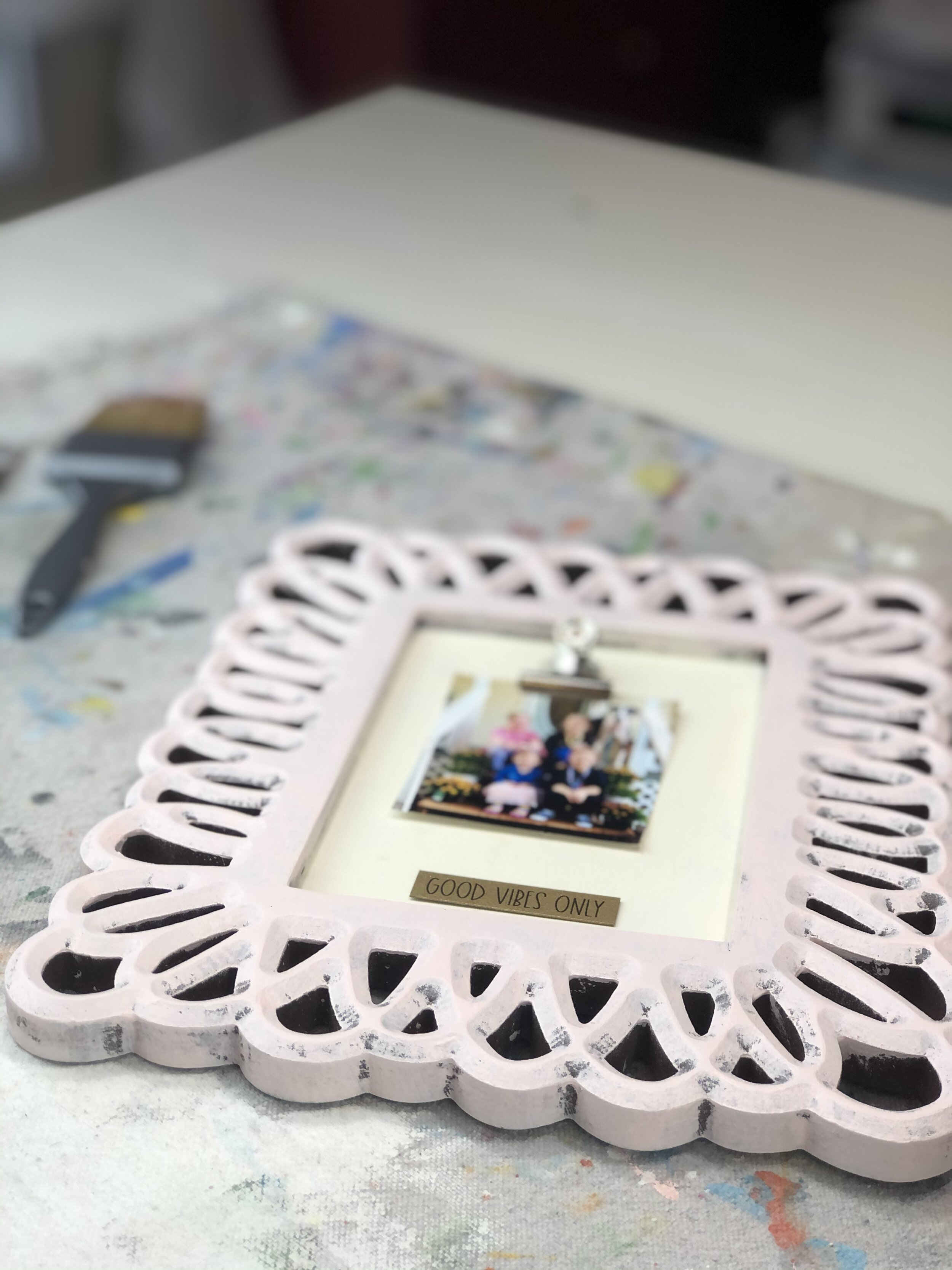 DIY Hobby Lobby clearance picture frame makeover. How to use Dollar Tree office clips to makeover an old picture frame.