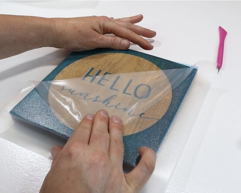 DIY how to stencil on wood sign painting tutorial. How to make a hello sunshine lettered sign for summer. Using oramask stencil film to paint wood signs without paint bleed. free svg to use with cricut for sign making.