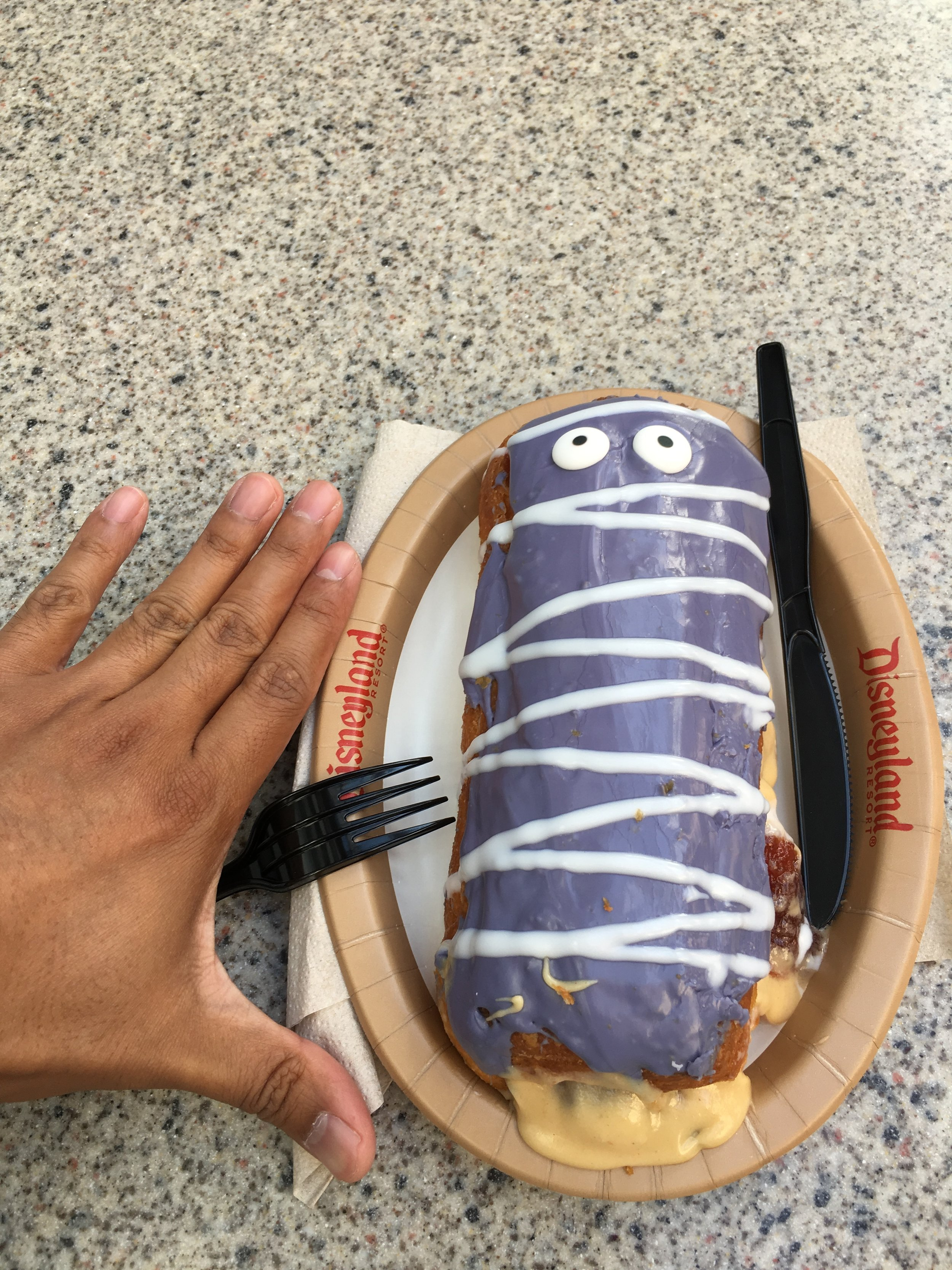 Peanut Butter and Jelly Cronut from Schmoozies in DCA. My Hand is next to it to show the size.