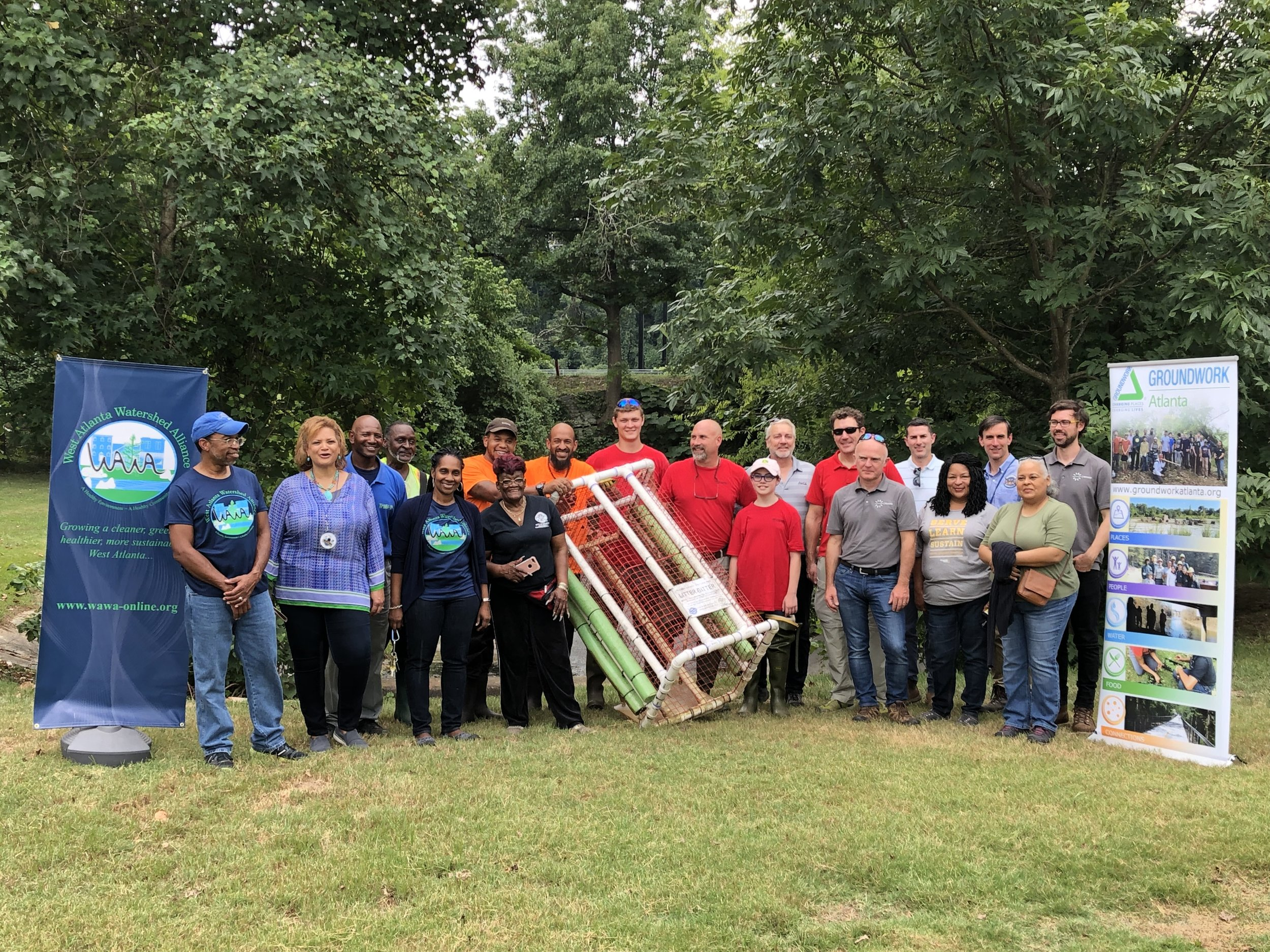 """Installation of Osprey Initiative, LLC """"Litter Gitter"""" technology in Westside Atlanta with project team and stakeholders.  """"Litter Gitter"""" is a small stream litter collection device used to intercept floating litter from stormwater runoff."""