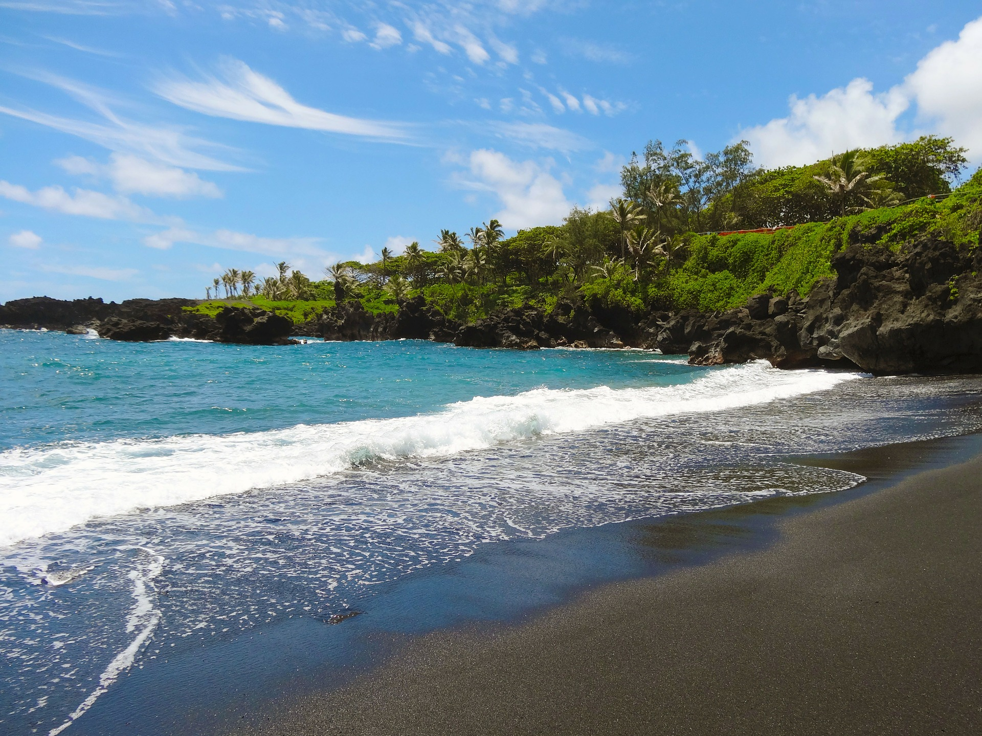 Welcome to Maui - Black sand, blue skies.