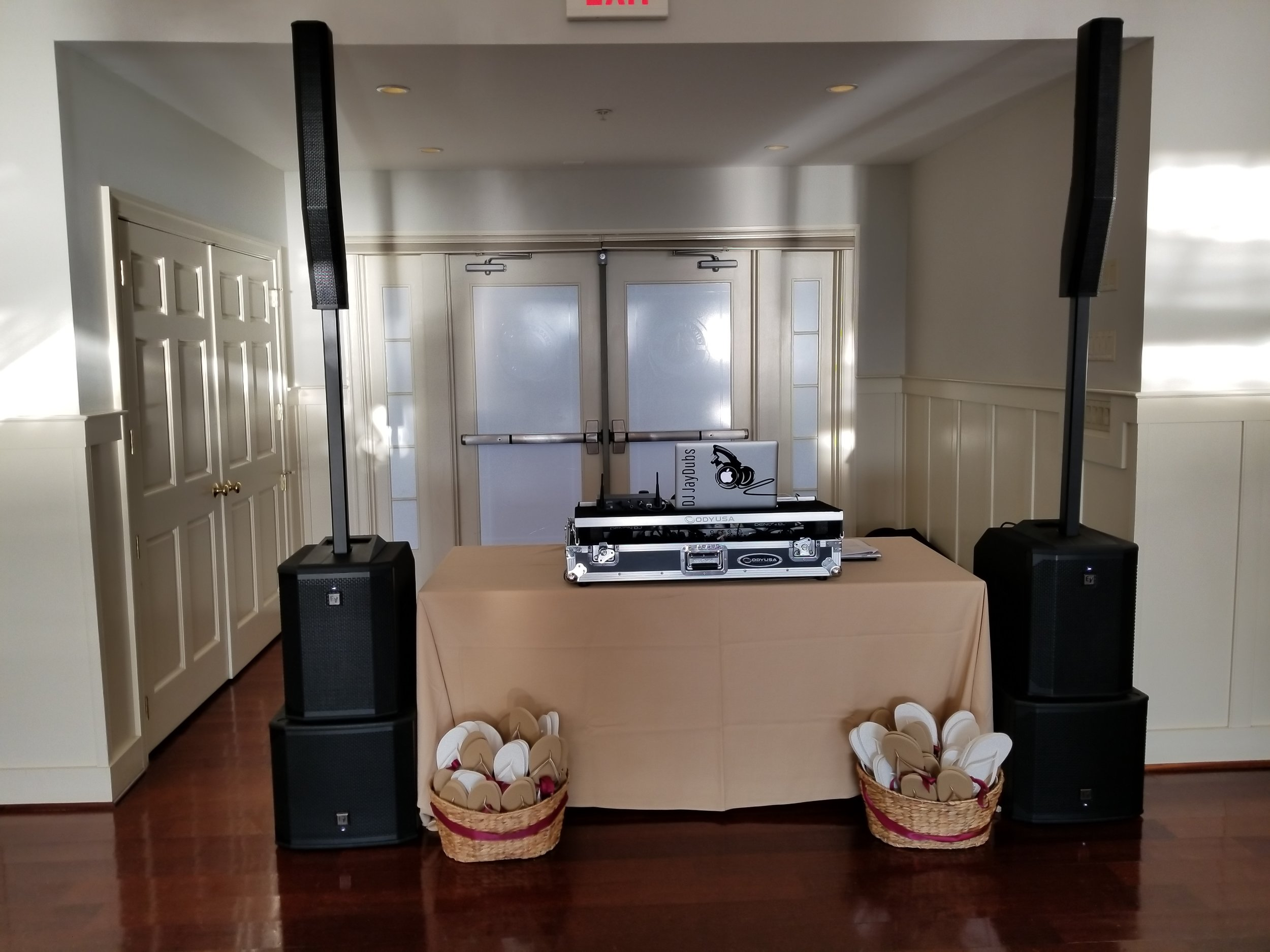 "Our new EV Evolve50 vertical array speakers perched on top of matching EV 12"" sub-woofers make for a clean presentation and they pack a 3,500 watt punch at CBBC's Beach House. Check out the client's flip flop basket - a great idea that allows the ladies to be more comfortable on the dance floor."