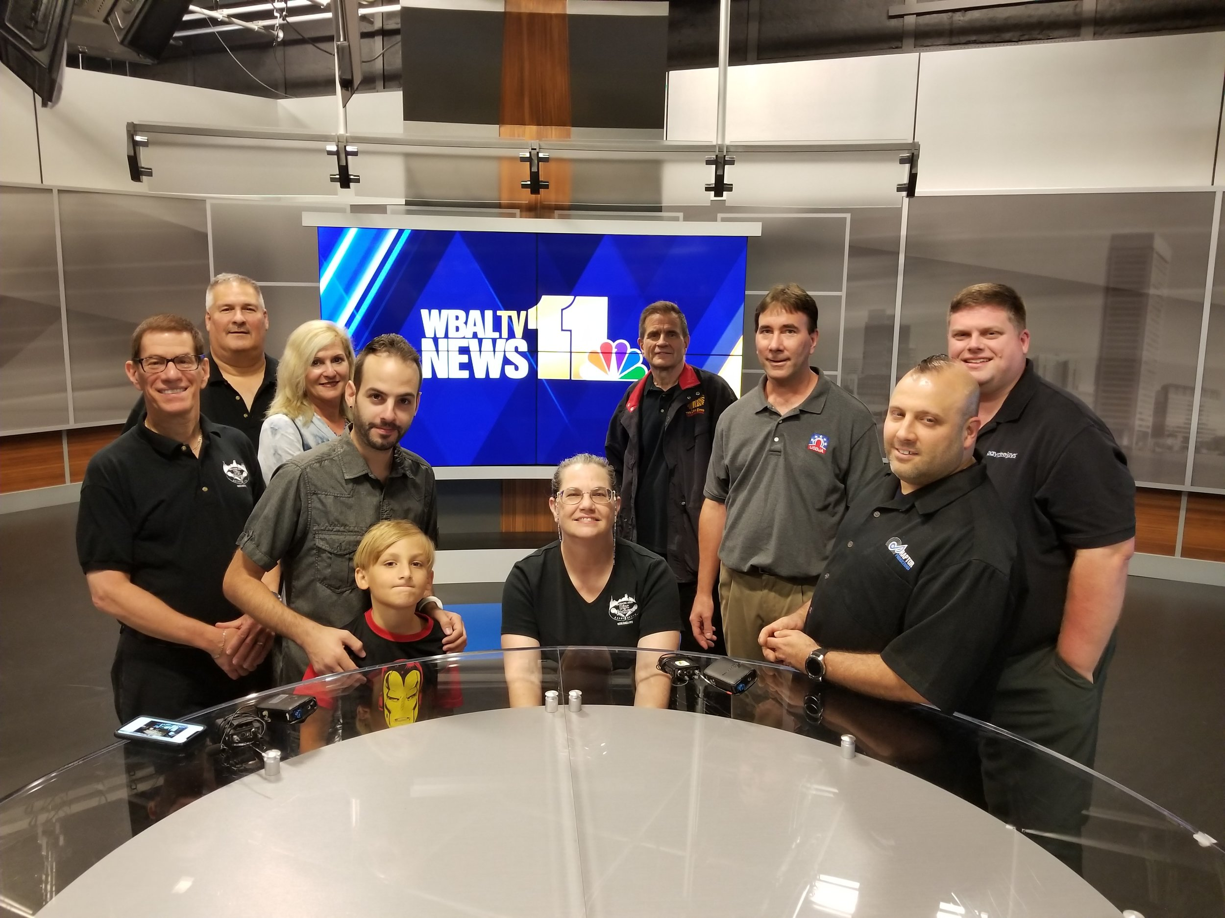 Jason (back, far right) and some members of the Baltimore Area Disc Jockey Association visit WBAL-TV, WBAL Radio, and 98Rock, all part of our monthly continuing DJ education.