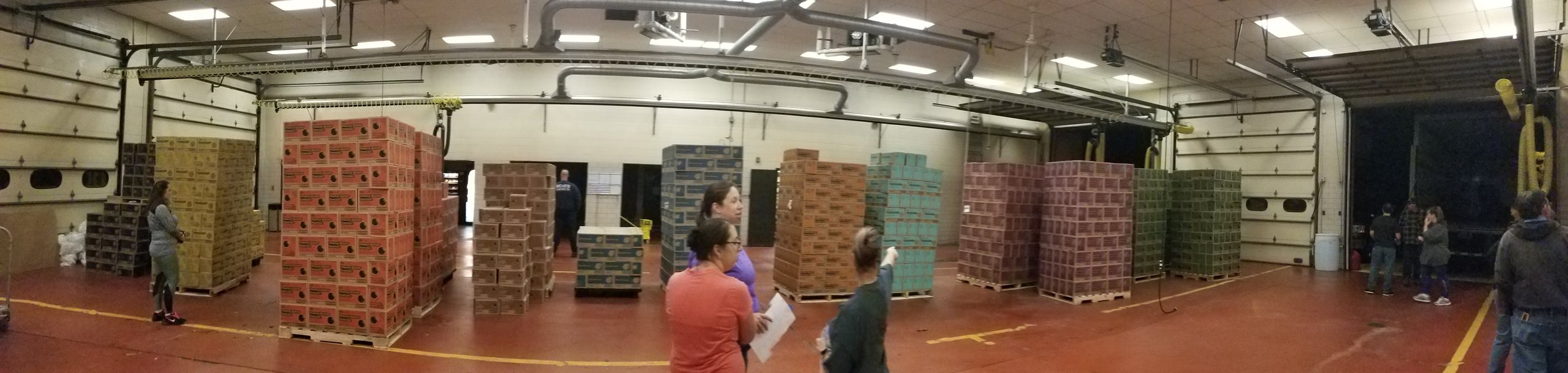 Helping sort and pack thousands of boxes of Girl Scout Cookies at our local fire station at 5am.