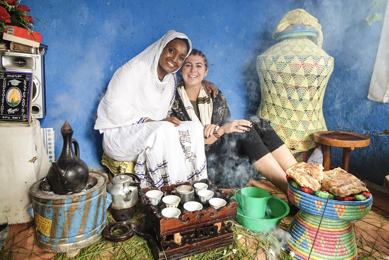 Director Brooke Bierhaus sharing a coffee with Tirunesh at her home in Lalilbela, Ethiopia.