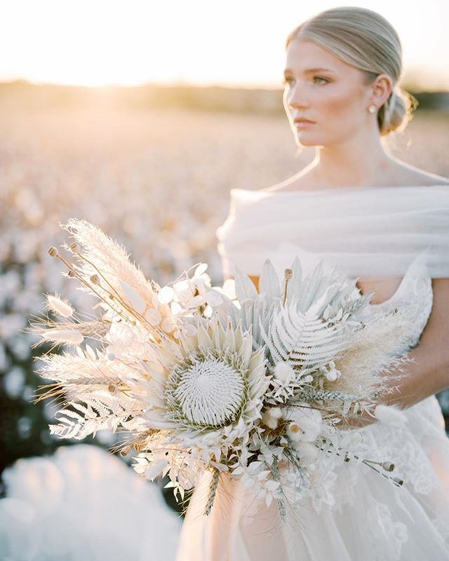 yesterday was so dreamy. ✨ dried florals for the win.  photography: @ashleyupchurchphoto  dress: @ellejamesbridal  hair + makeup: @mollygeeandco  model: @savannah.falcone