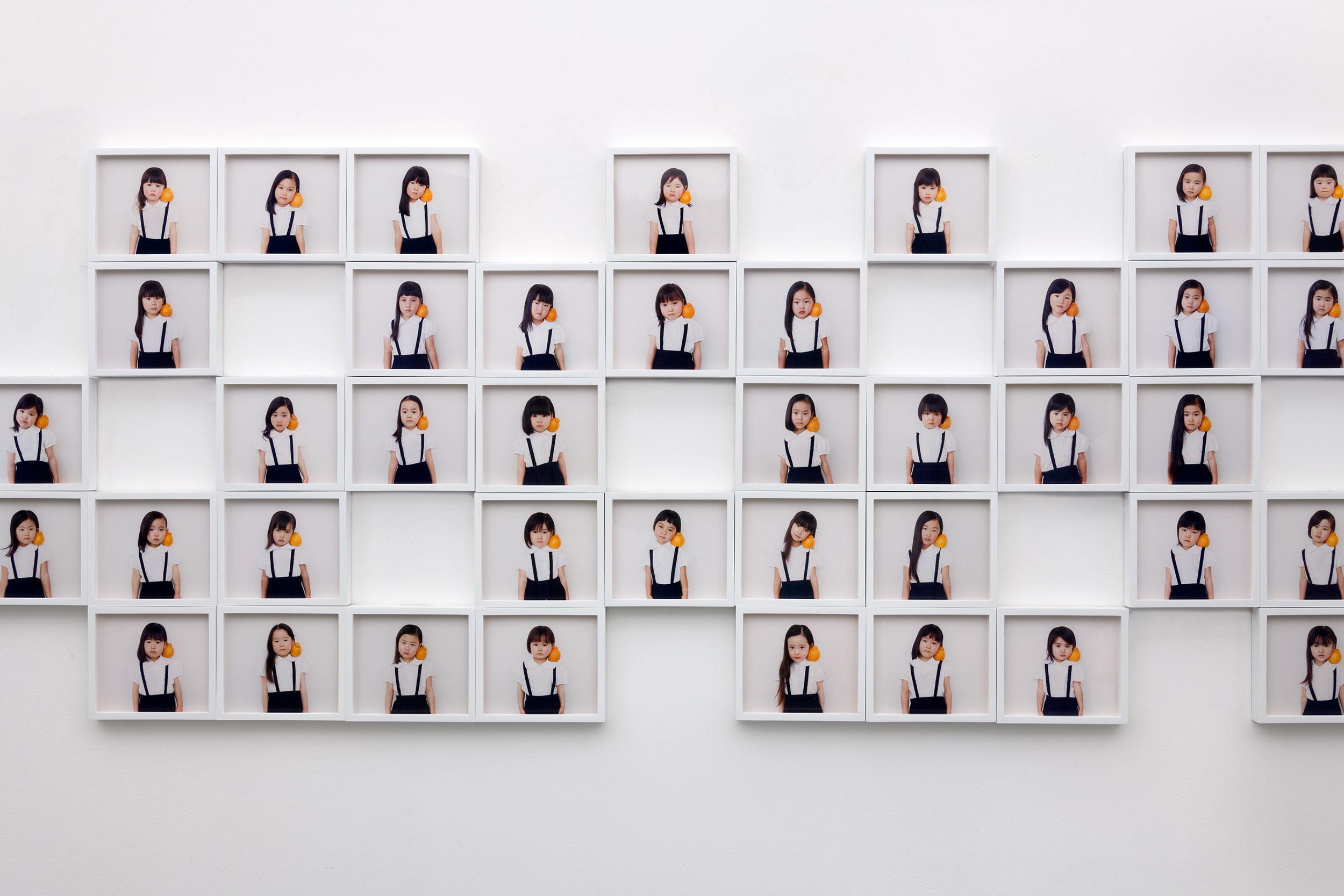 Osamu Yokonami,  1000 Children: Sumo Mandarin (installation view) , 2018  (75) digital pigment prints, 146 x 168 mm each (approx. 5.5 x 6.6 in each), framed, $240 each   Inquire