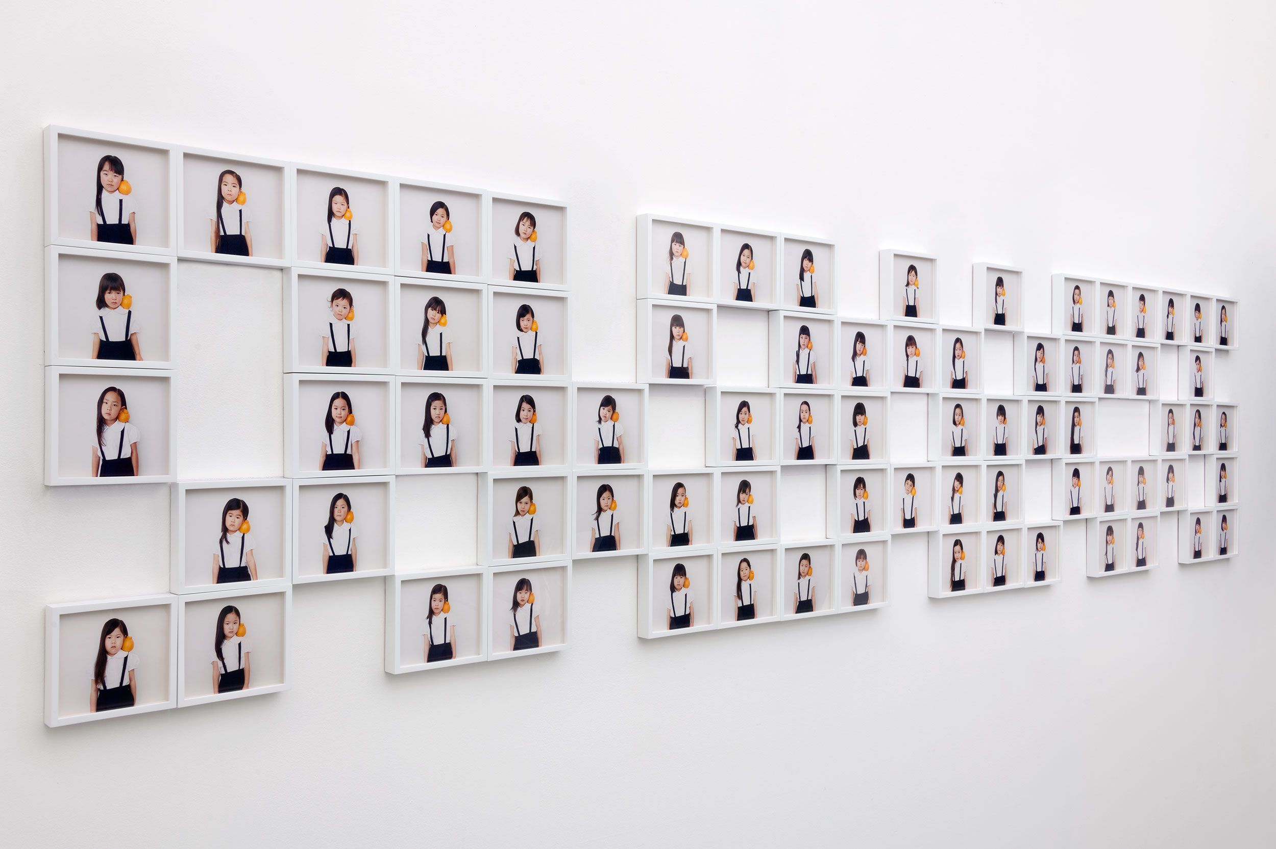 Osamu Yokonami,  1000 Children: Sumo Mandarin (installation view) , 2018  (75) digital pigment prints, 146 x 168 mm each (approx. 5.5 x 6.6 in each), framed, $240 each   Inquire