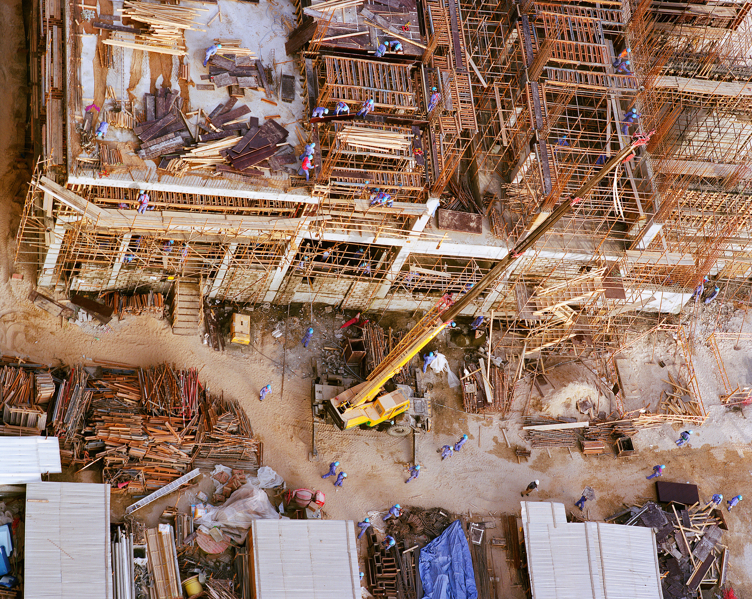 Connie Samaras,  After the American Century: Construction Laborers, Sheikh Zayed Road, 2009   Digital pigment print, 40 x 48 inches, edition of 5   Inquire