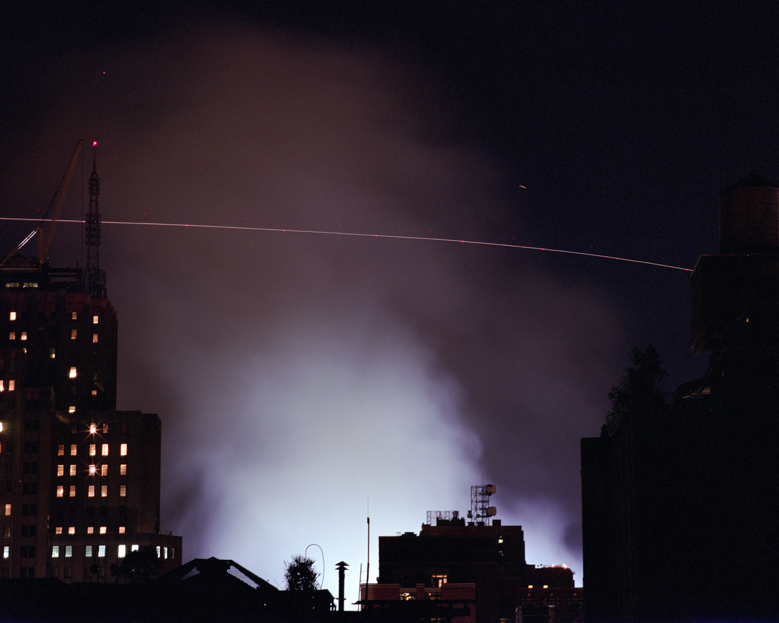 Connie Samaras,  Angelic States - Event Sequence: No Fly Zone, F16 Circling WTC Fires , 9.14.2001  Digital pigment print, 40 x 50 inches, edition of 5   Inquire