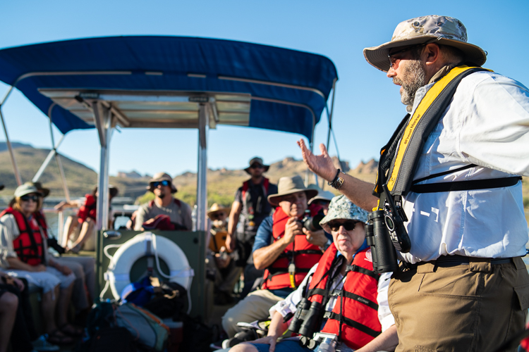 Jeff from AZGFD explaining that sheep are poor swimmers, in part due to their massive horns. A body of water can permanently separate two herds, which is the case at Canyon Lake.