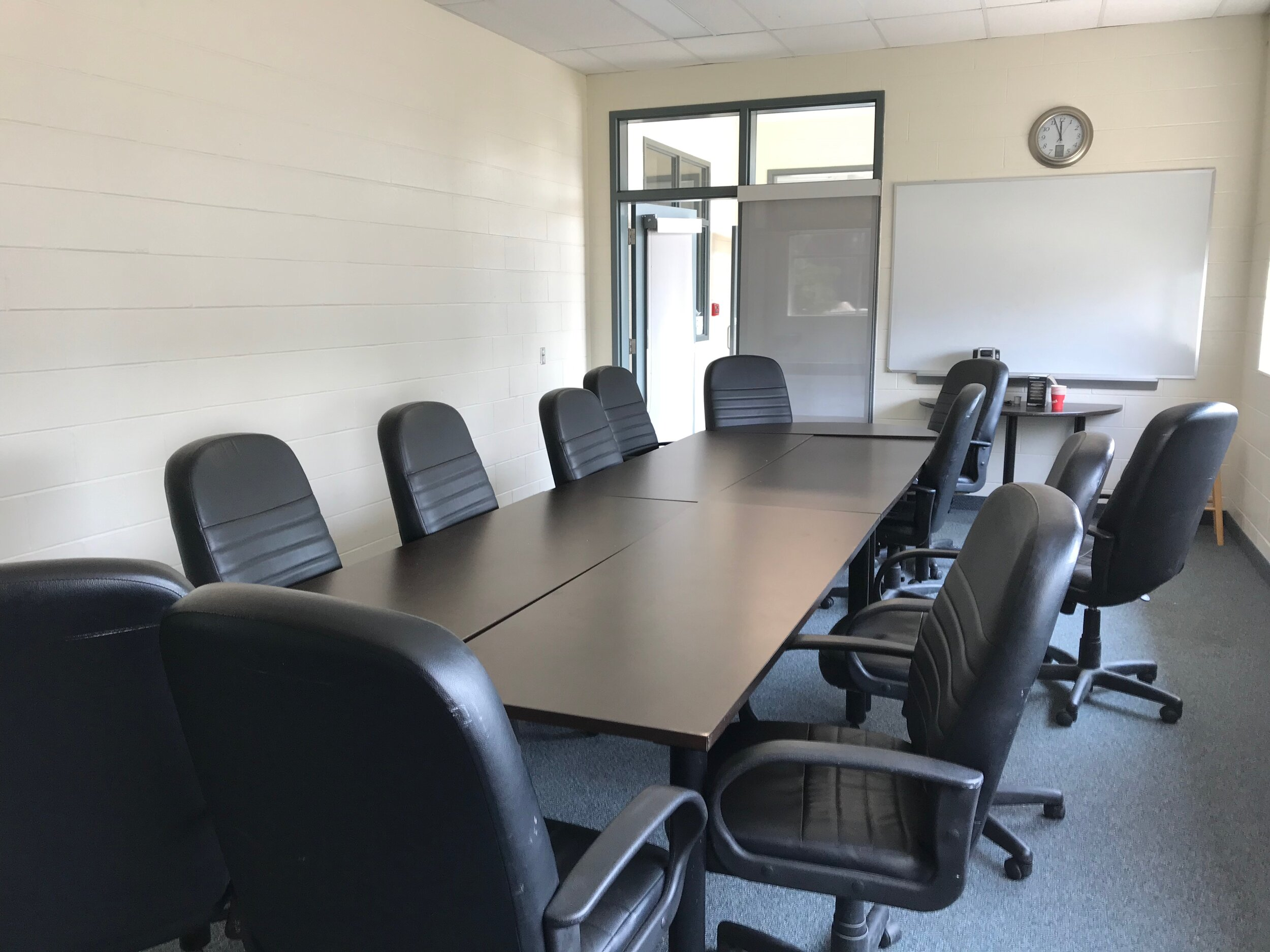 Our Meeting Room - The Board Room comfortably seats 12 people. Consider it for your next meeting. Wifi enabled.