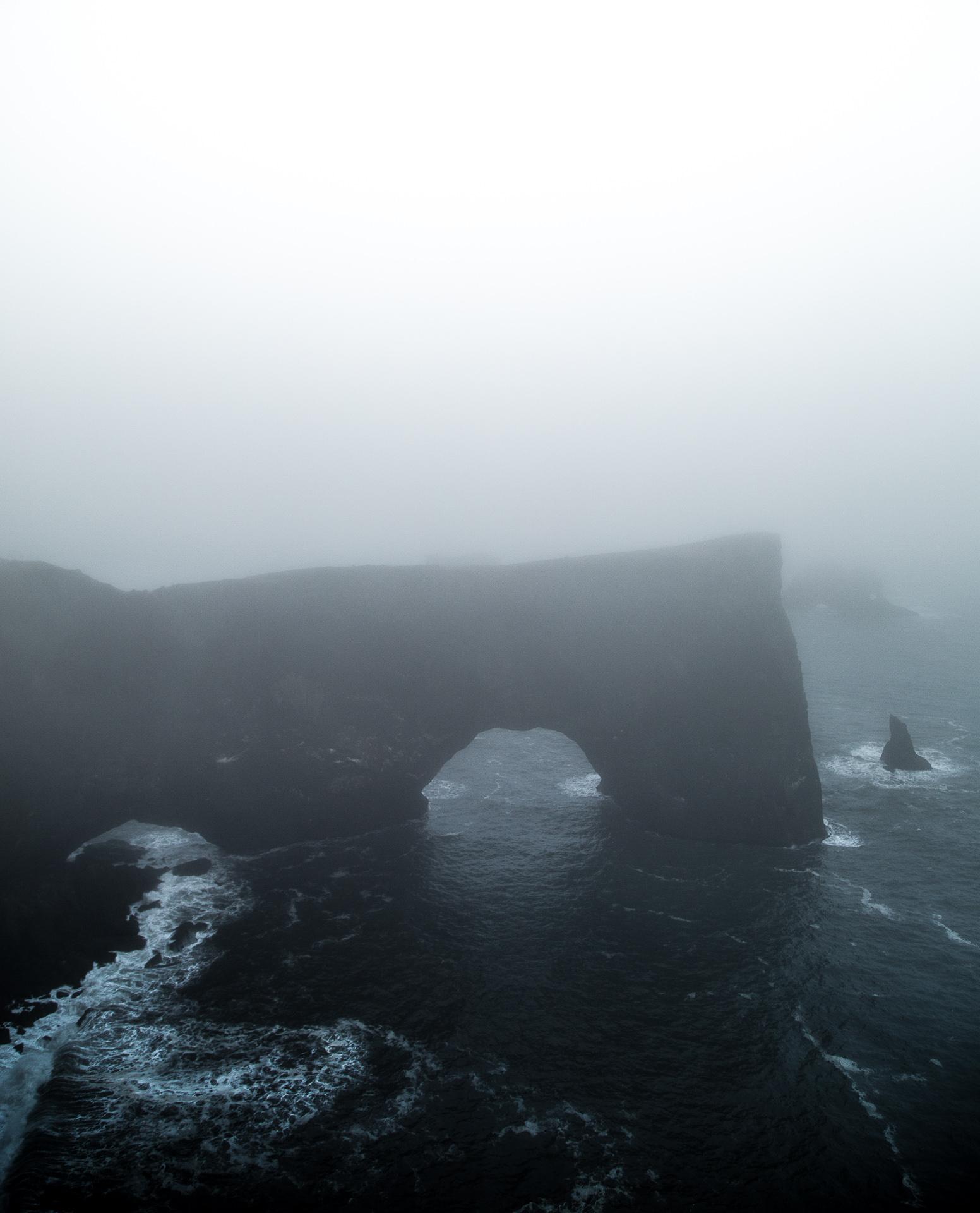 iceland dyrholaey arch fog coast