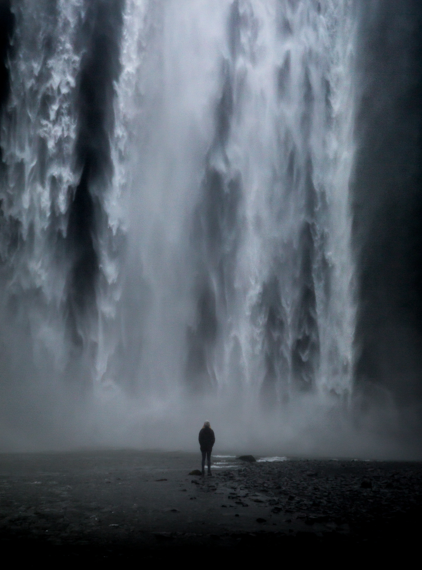 standing in front of skogafoss waterfall iceland