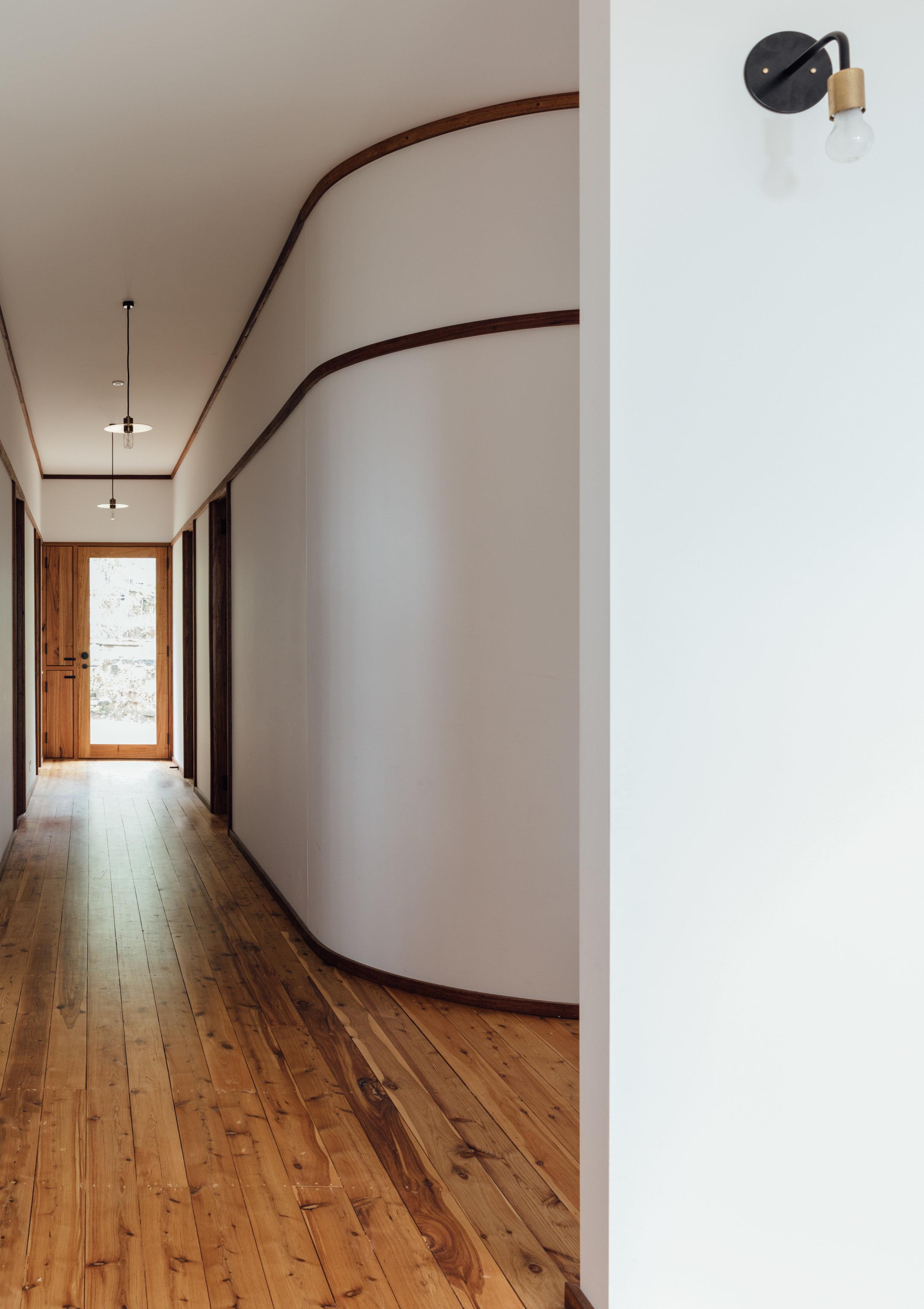 Takt exoskeleton house hallway curved.jpg