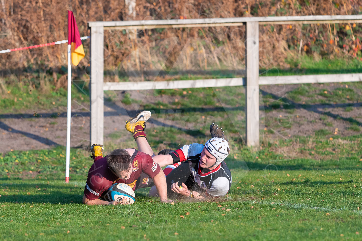 Billy Ward clears the line despite a high challenge (Photo: Iain Frankish, Actuance Photography)