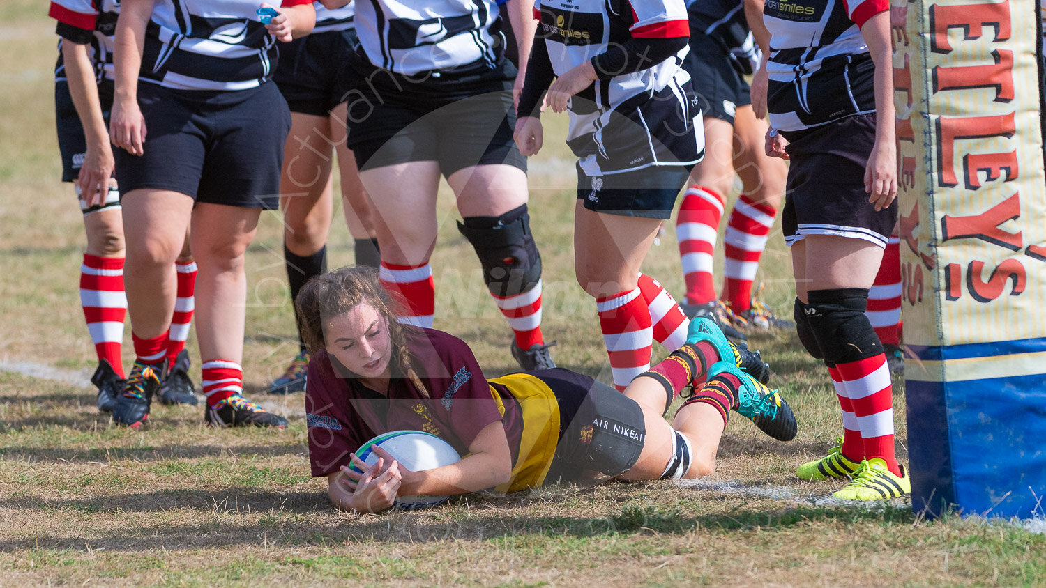 Annie Tomblin crosses the whitewash to score her first try for Ampthill (Photograph: Iain Frankish, Actuance Photography)