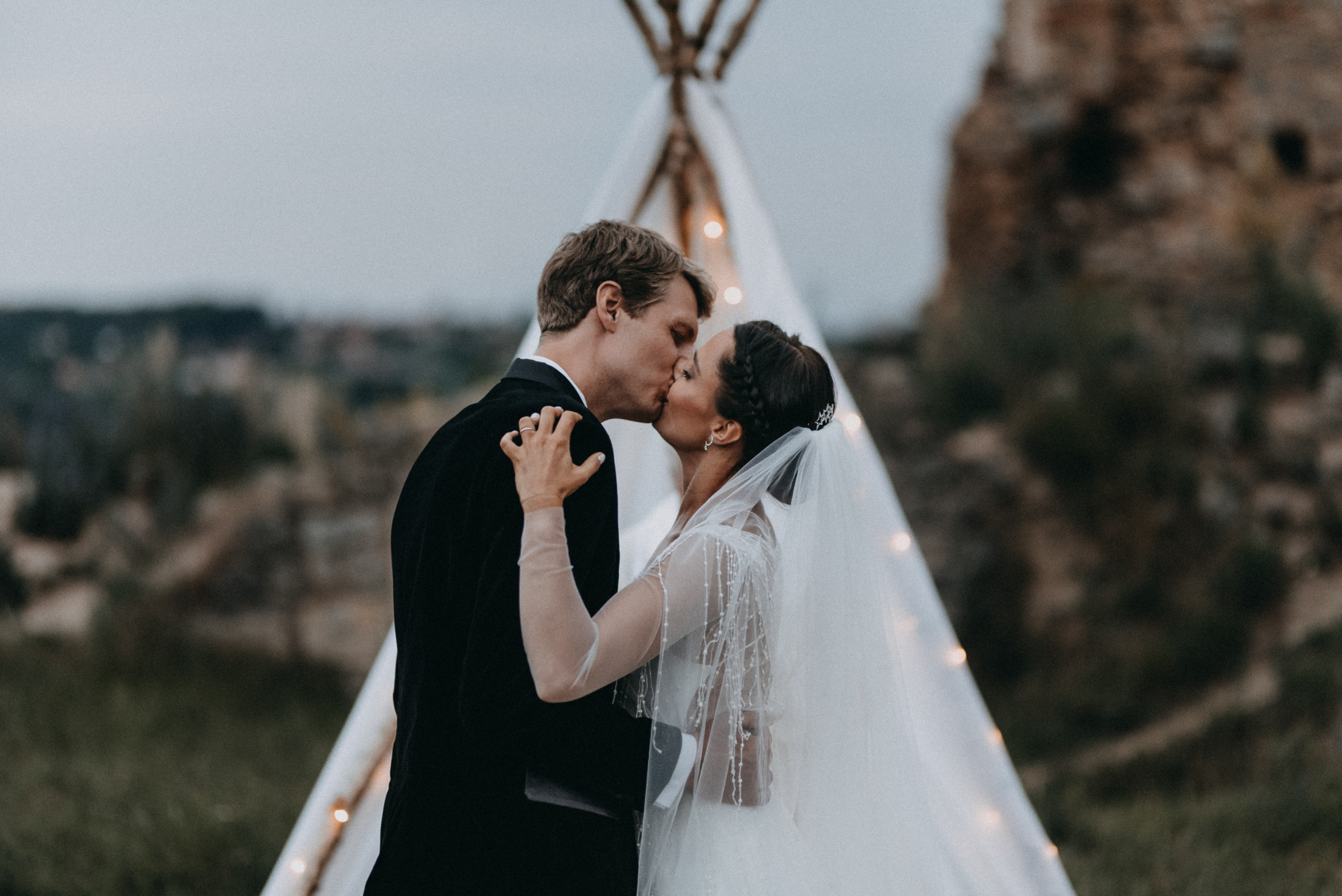 evening castle ruins wedding ceremony first kiss