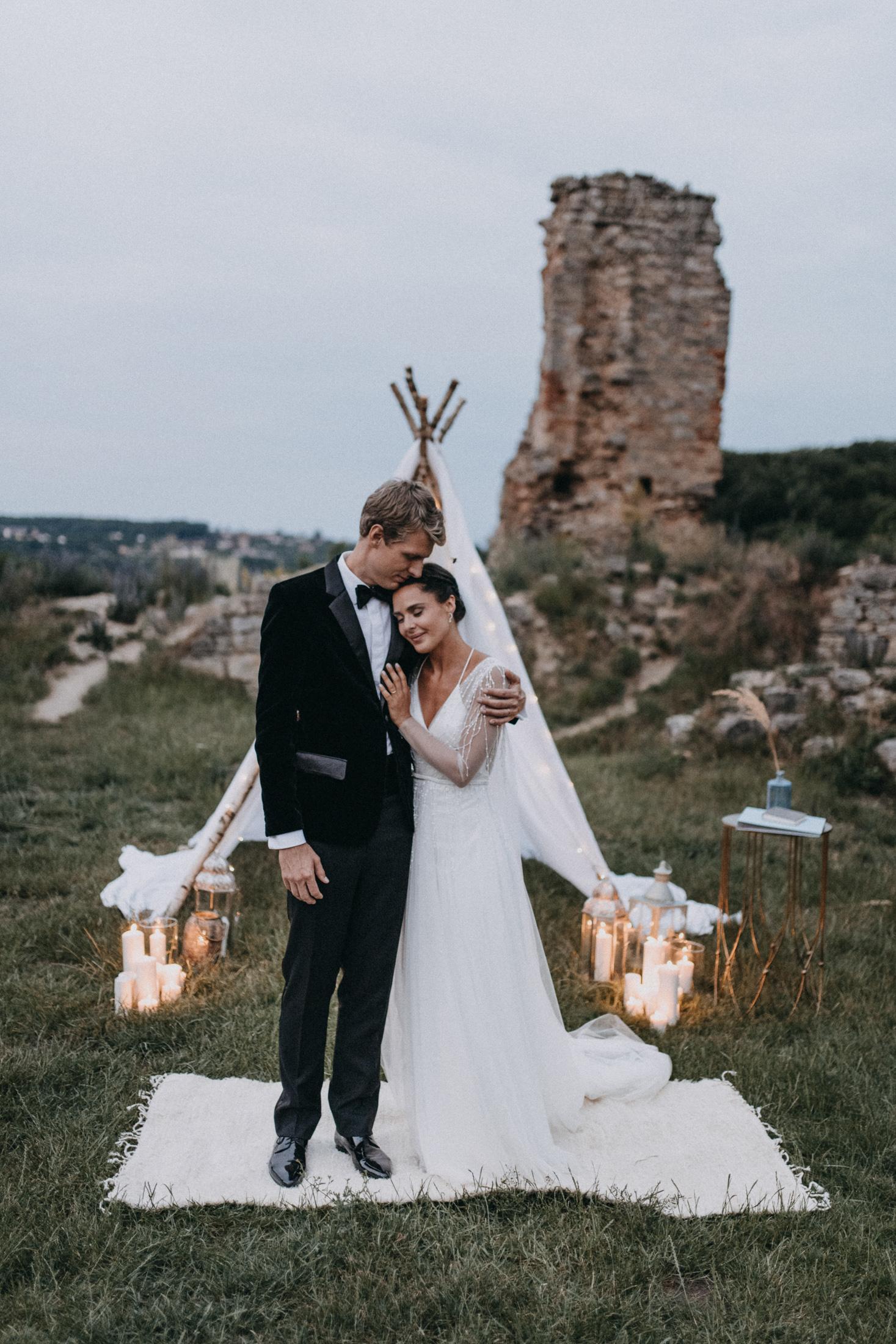evening castle ruins wedding ceremony