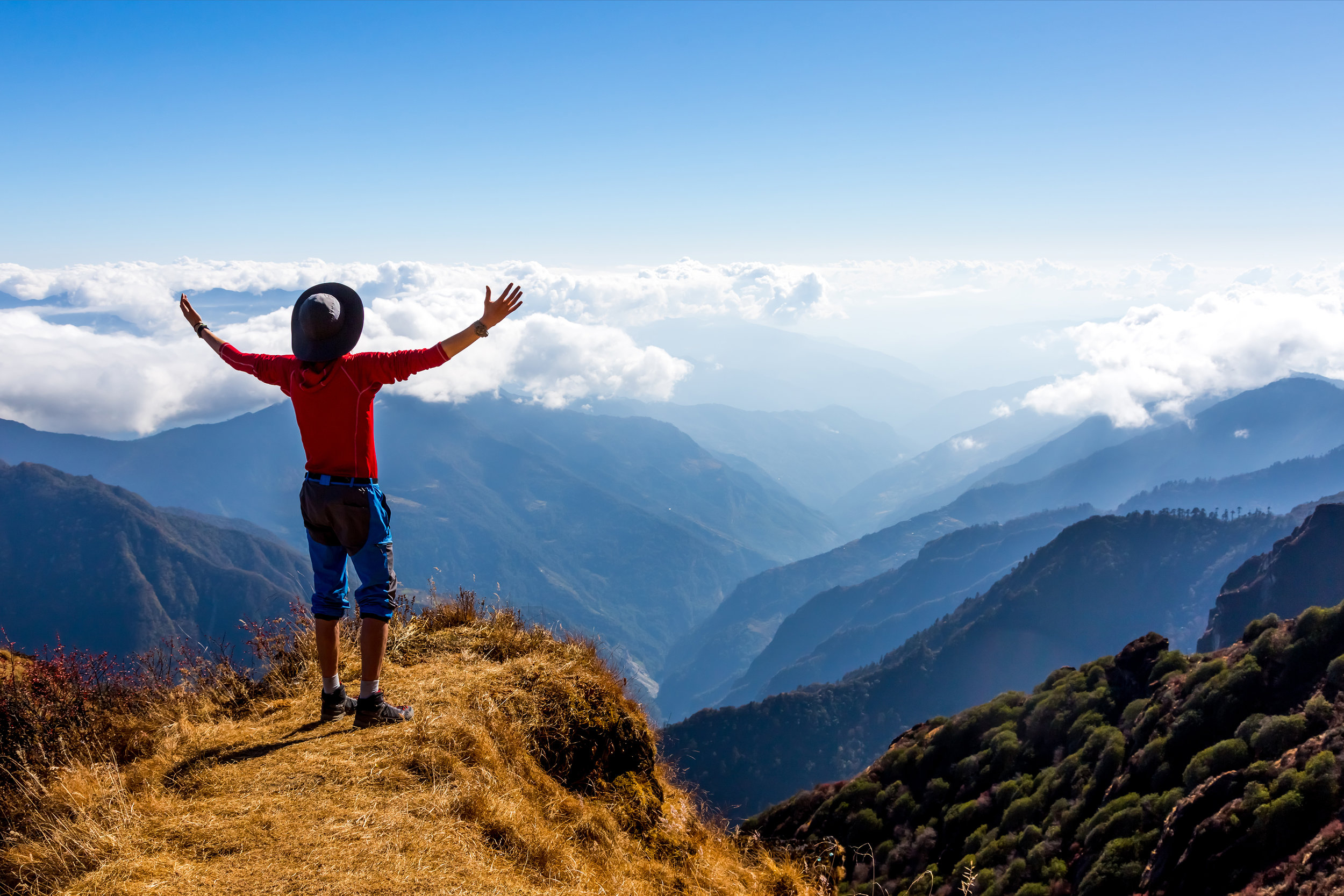 Sunny Mountains Horizon View and Silhouette of happy excited Person staying on Cliff and making I feel well gesture.jpg